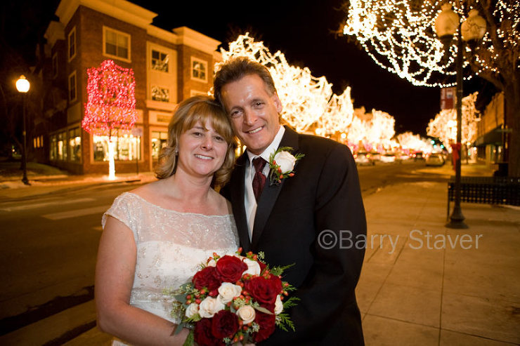 A remote flash was used from the right to illuminate the couple. Camera and flash set on Auto exposure ~ achieving great lighting balance between foreground and background.